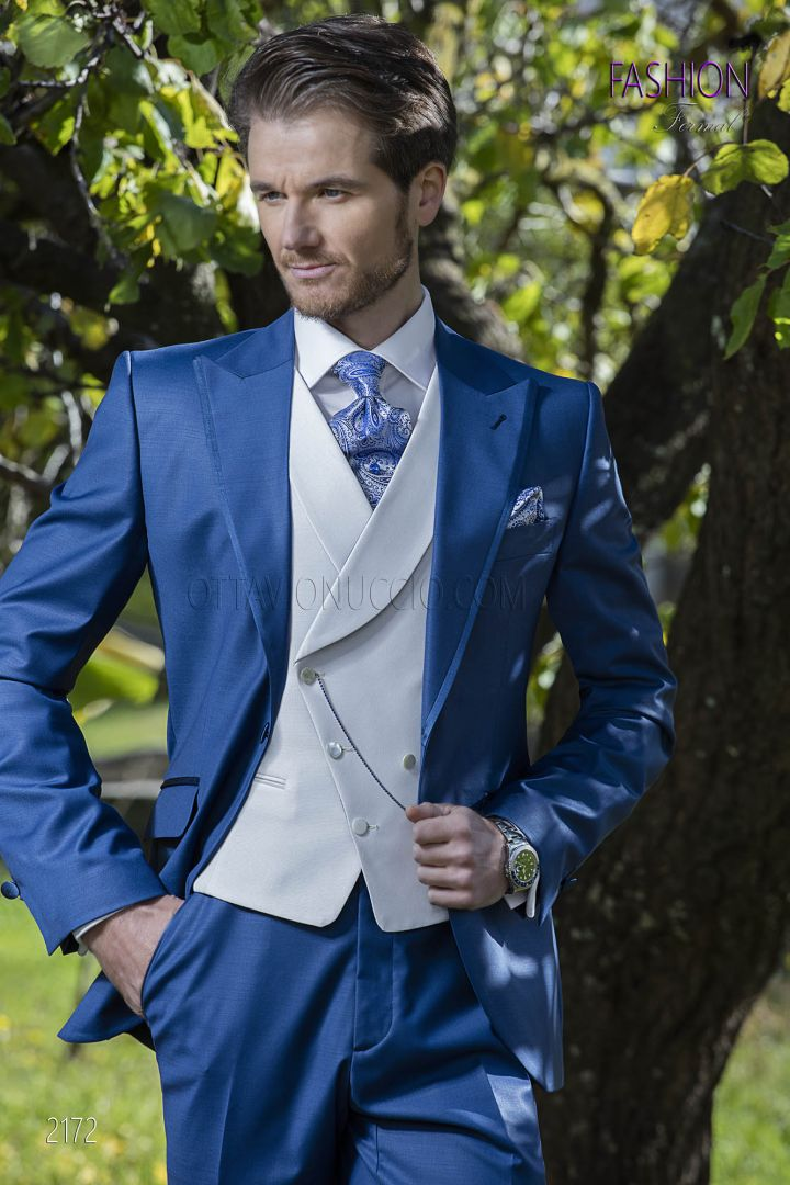 Bespoke italian wedding suit in blue wool blend with white vest