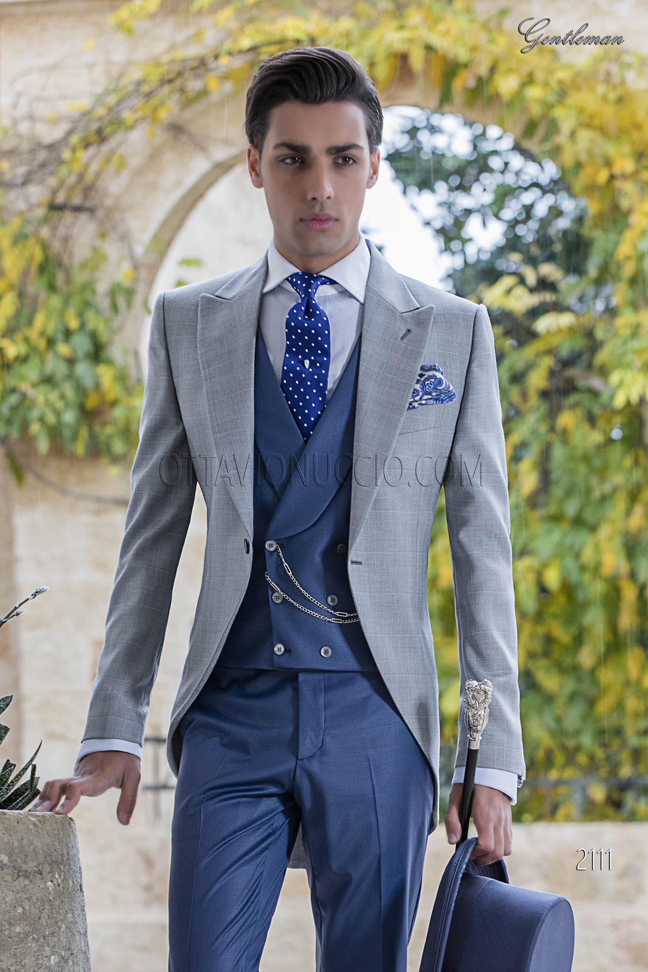 Light grey Prince of Wales groom suit with blue combination