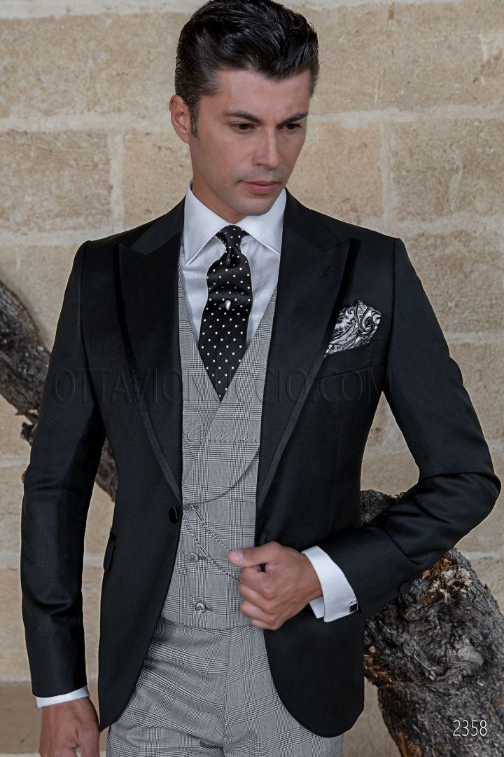 Traje de novio moderno negro, chaleco de sociedad y pantalón príncipe de gales