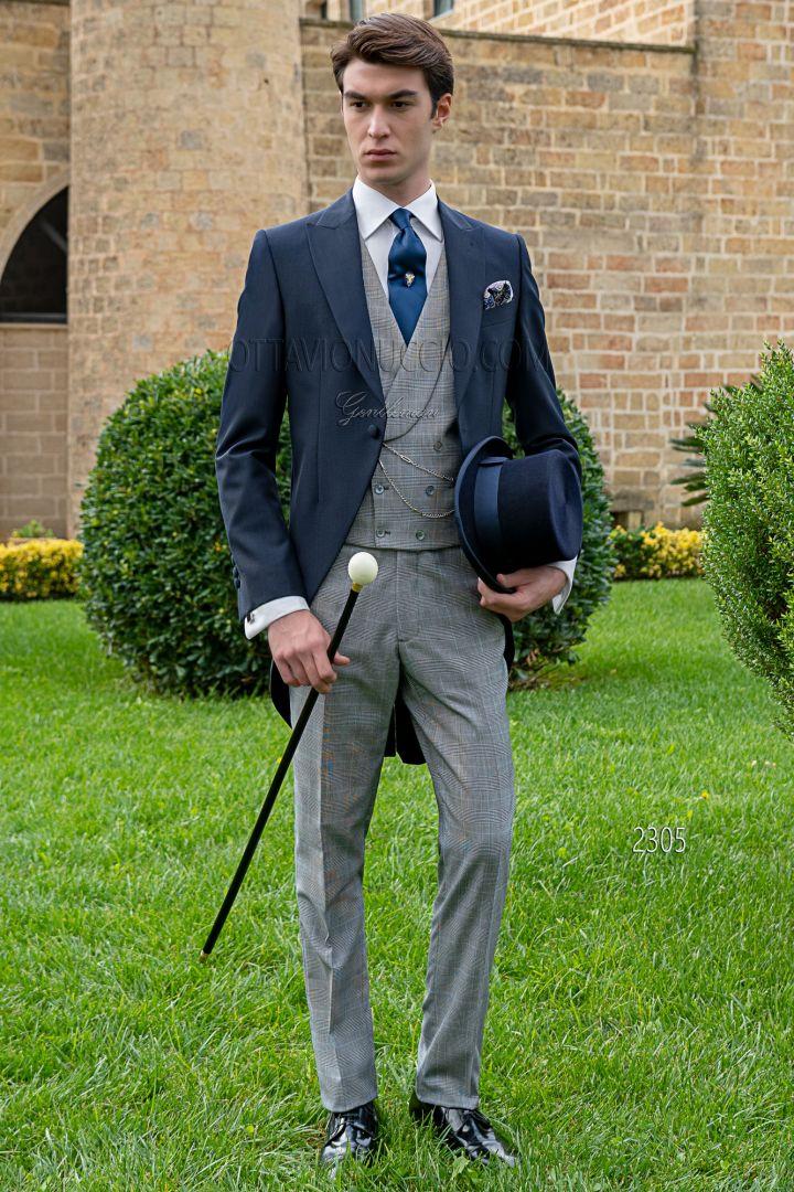 Tight sposo blu con gilet e pantalone principe di galles