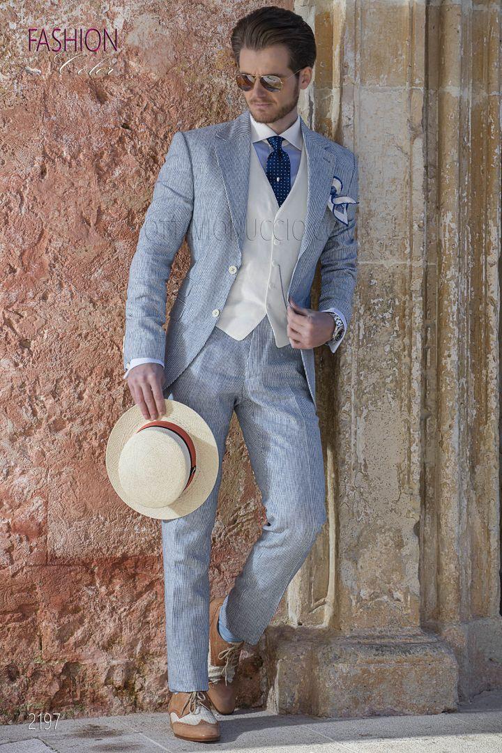 Traje italiano vintage celeste de lino con chaleco blanco