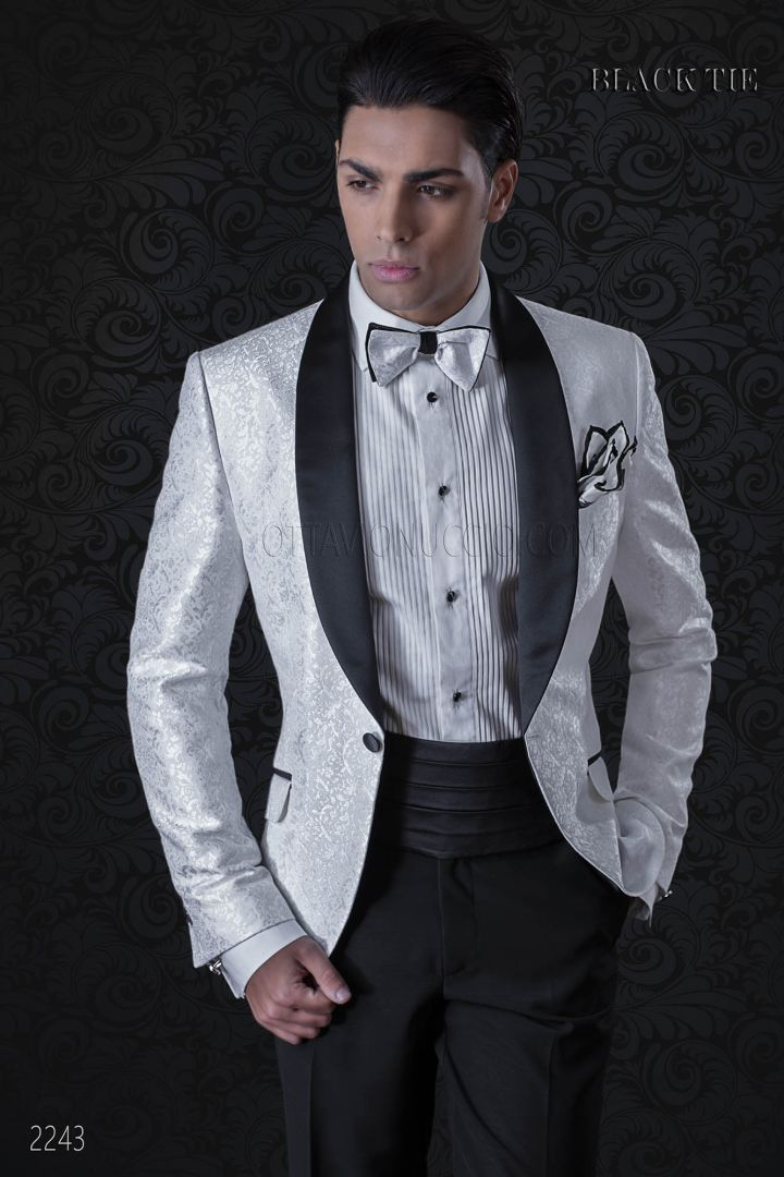 White dinner jacket with black shawl collar and black trousers